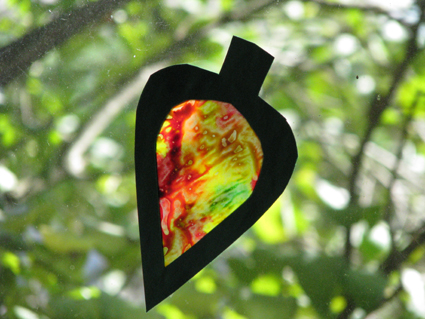 wax paper stained glass Craft: capture the colors of fall with this stained glass-like decoration   assortment of fall leaves black construction paper wax paper crayons (or  crayon.