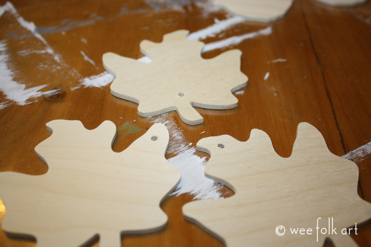 painted wooden leaves drilled