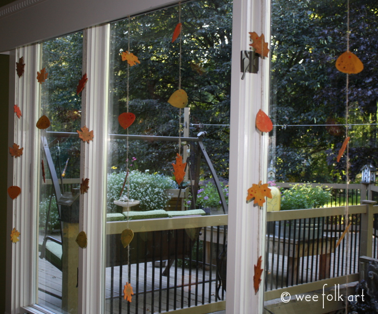 painted wooden leaves in the window