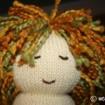 Knitted in the Round 12″ Baby Doll – Part 2 – Adding Hair and Face