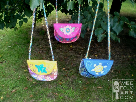 Three handmade treasure pouches with a leaf, a flower, a turtle applique.