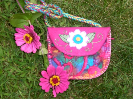 A handmade treasure pouch with embroidered flower for kids to use for collecting items from nature.