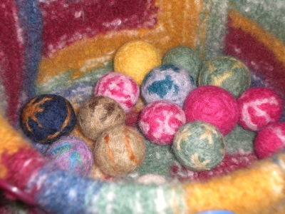 Free pattern for wet felted wool marbles made from scrap yarn.