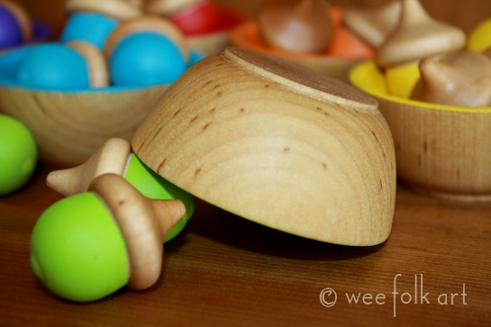 painted wooden bowls and wooden acorns craft